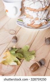 Custard cake with white chocolate on the saucer