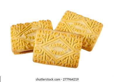Custard Cream biscuits over a plain white background.