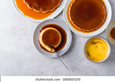 Custard Creme Caramel Flan dessert oven cooked. Homemade milk and egg dessert with caramelized sugar sauce on stone gray background