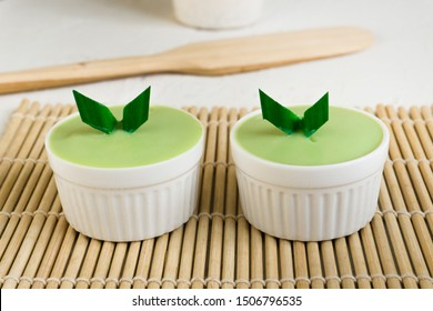 custard in white cup, pandan custard with green color on white table