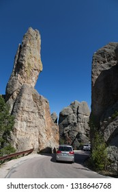 CUSTER STATE PARK, SOUTH DAKOTA - June 9, 2014:  Cars driving on the Needles Highway next to tall quartz rock formations in Custer State Park, SD on June 9, 2014.
