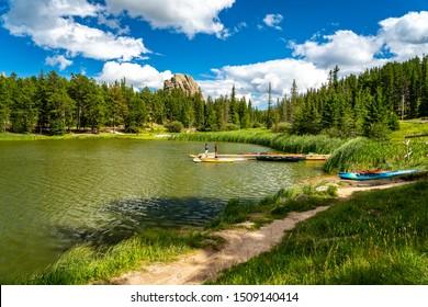 Custer state park, South Dakota, USA - Aug 26 2019: People fishing on Sylvan lake