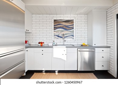 Custom Beach House Kitchen With Beautiful Tile Work & Industrial Shelving