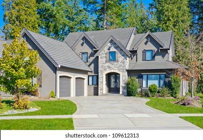 Custom built big luxury house with double doors garage in a residential neighborhood. Suburbs of Vancouver ( Surrey ) Canada.