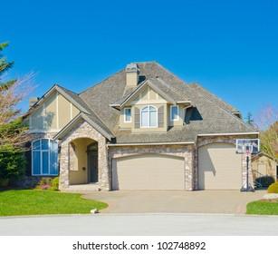 A custom built triple garage doors luxury house in a residential neighborhood. North America.