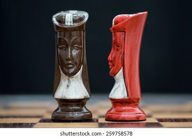 Custom designed queen chess pieces on custom wood board.