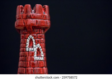 Custom designed red castle piece from chess.