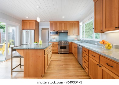 Custom designed wooden kitchen with gorgeous granite counter to