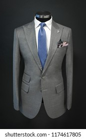 Custom expensive tailored suit on mannequin, isolated on background