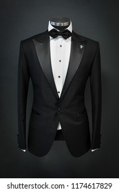Custom expensive tailored suit, tuxedo on mannequin, isolated on background