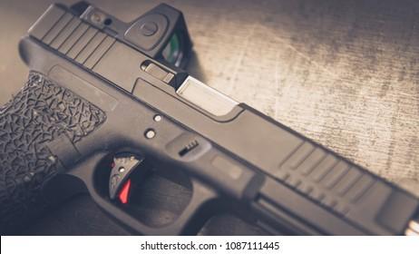 Custom Handgun laying on on table close up