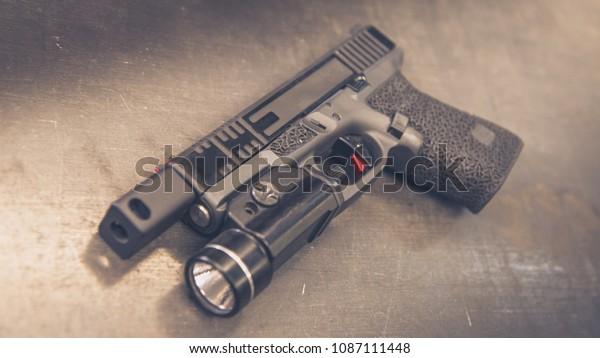 Custom Handgun Laying On Table Compensator Stock Photo (Edit