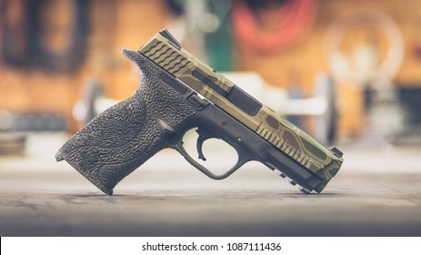 Custom Handgun on table camo slide profile