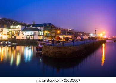 Custom House quay harbour Falmouth at Dusk on a foggy evening. Cornwall England UK Europe