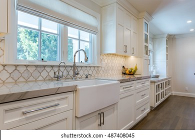 Custom Kitchen Cabinets, Custom Tile, White and Clean