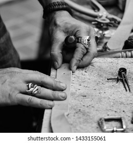 Custom leather work at war veteran museum display in black and white