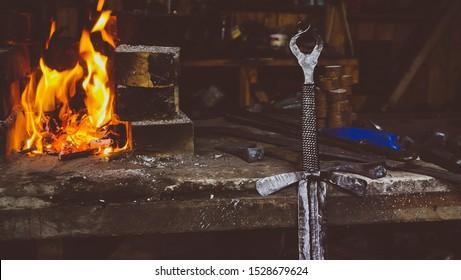 Custom made sword next to a fireplace