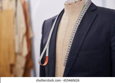 Custom made tailored suit on mannequin in atelier studio