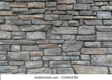 Custom stone wall on side of building