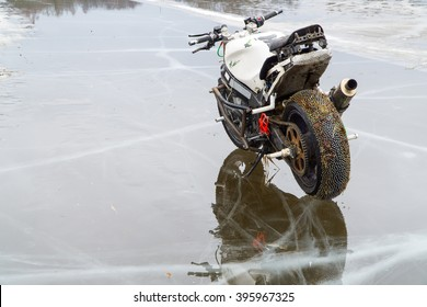 Custom Stunt Motorcycle Water Mirror On Frozen Lake. Winter Racing On Ice Using Special Threaded Tires.
