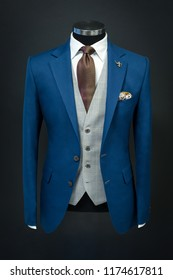 Custom tailored suit on mannequin, isolated on background