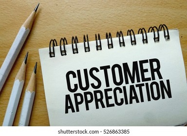Customer Appreciation text written on a notebook with pencils