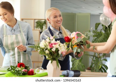 Customer buying flowers in shop