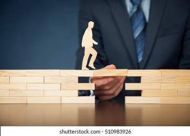 Customer care, support (help) and life insurance concept. Businessman representing company helps (support) customer (client) to overcome an obstacle. Problem solving with smart and simple solutions.
