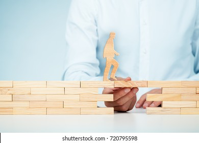 Customer care, support (help), personal development and life insurance concept. Businessman representing company helps (support) customer (client) to overcome an obstacle.