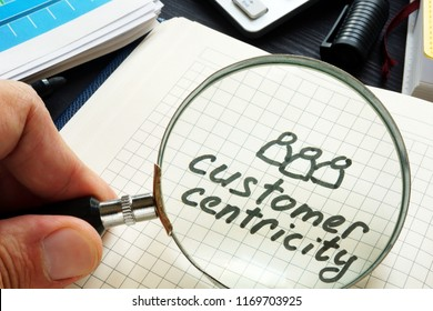 Customer centricity handwritten in a note pad.