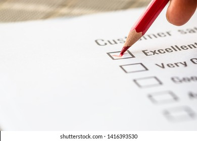Customer checklist survey exellent form for feedback satisfaction mark over application forms document with red pencil. Opinion question botton for filling checkmark for business