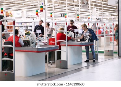 Customer at the checkout makes purchases in the store. Auchan. Moscow. 30.07.2018