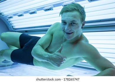 Customer or client in a solarium on tanning bed