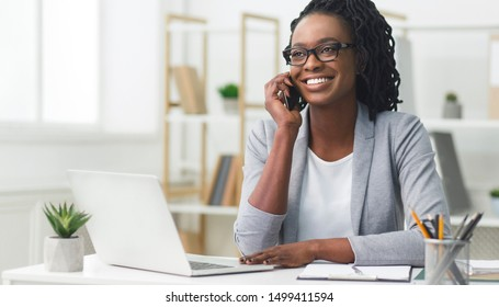 Customer Communications. Office Girl Having Phone Conversation With Client Sitting At Laptop In Modern Office. Free Space