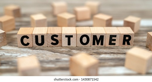 customer concept on wood cubes