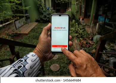 A customer is creating a new account at Shutterstock in Bekasi, West Java, Indonesia, on July 20, 2019.