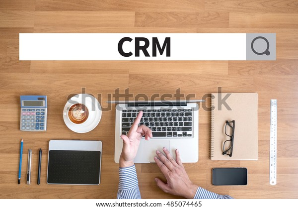 Customer CRM Management Analysis Service Business CRM Businessman working with financial reports and a laptop with other objects around, coffee,  top view