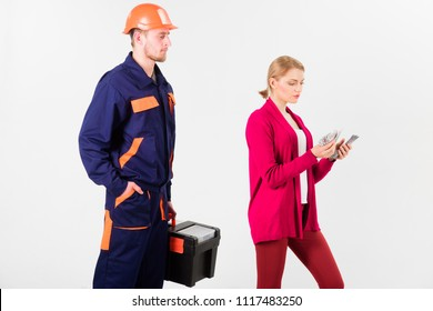Customer deceives repairman, builder, mechanic. Repairer, builder wants salary for work. Deceive concept. Builder in helmet looks at woman with busy face counting money, isolated on white background.