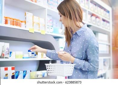 Customer examining medicament in drug store