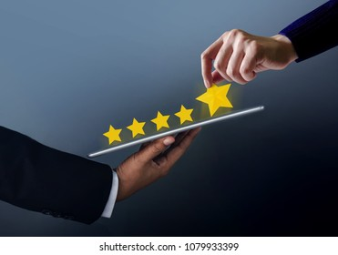 Customer Experience Concept. Best Excellent Services for Online Satisfaction Survey present by Hand of Client giving a Five Star Rating on Digital Tablet
