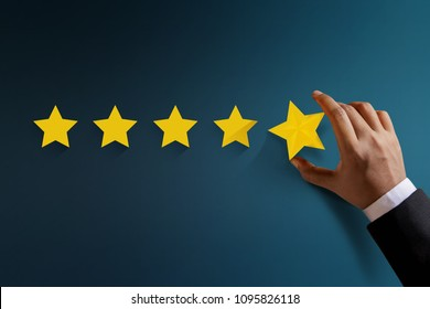 Customer Experience Concept, Best Excellent Services Rating for Satisfaction present by Hand of Happy Businessman Client Feedback for a Five Star