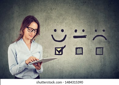 Customer experience concept. Happy business woman giving excellent rating for online satisfaction survey