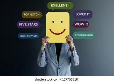 Customer Experience Concept. Happy Client standing at the Wall with Smiling Face on Paper. Surrounded by Positive Review in Speech Bubble
