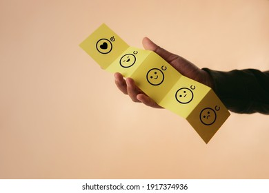 Customer Experience Concept. Happy Client giving Positive Review on Fold Paper. Feedback icon from Poor to Exellent for Products and Services. Client Satisfaction Surveys. Marketing Strategy
