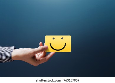 Customer Experience Concept, Happy Client Woman show a Feedback with Happy Smiley Face Card
