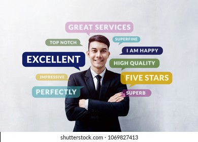 Customer Experience Concept. Happy Young Client standing at the Wall, Smiling and Crossed Arms, Looking at camera. Surrounded by Positive Review in Speech Bubble