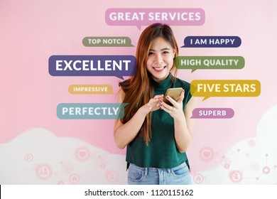 Customer Experience Concept. Happy Young Woman using Smart Phone to Read or Feedback her Satisfaction Online Survey. Surrounded by Social Icons and Positive Review in Speech Bubble