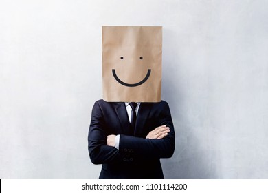 Customer Experience Concept, Portrait of Happy Businessman Client with Smiling Face Emotion on Paper Bag, Crossed arms and wearing Suit, Standing at the Concrete Wall