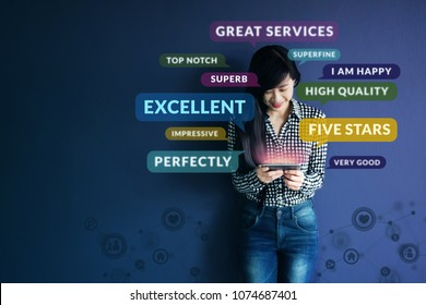 Customer Experience Concept. Soft focus of Happy Client standing at the Wall, Smiling while using Smartphone. Surrounded by Positive Review in Speech Bubble and Social Network icons