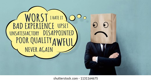 Customer Experience Concept. Unhappy Businessman Client with Sadness Emotion Face on Paper Bag, Crossed arms and looking at Wording of Negative Reviews on Think Bubble